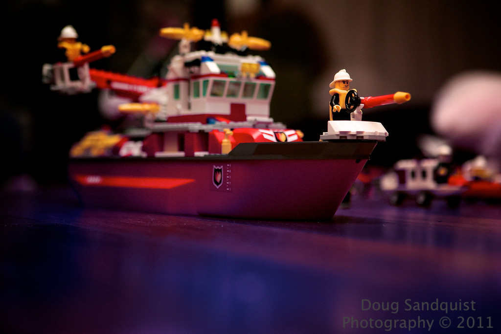 Lego fireboat... With an interesting attempt at adding water in the foreground, post... :)<br /> <br /> 11-04-2011