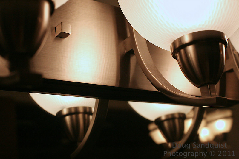 A little abstract tonight... I kind of liked the reflections and satiny finish on the light fixture.. <br /> <br /> 01-26-2011