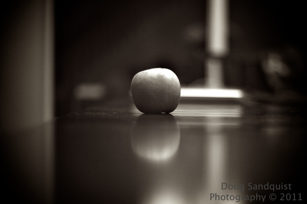 Busy day today.... Not a whole lot of time for pictures, so found this apple in the kitchen and decided to see what I could come up with quickly.... It's not very exciting, but I liked the processing and the reflection...<br /> <br /> 05-19-2011