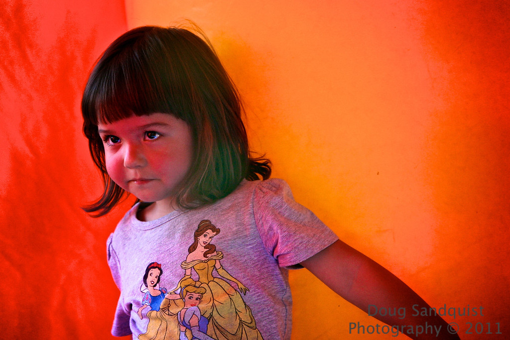 Orange glow from the bounce house! J and R had fun at a friends birthday party this evening! I liked the glow on her face from the bright orange sides of the house! <br /> <br /> 08-21-2011