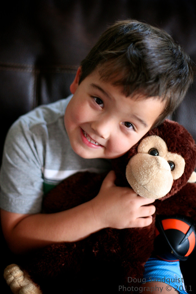 Reece wanted to help me with today's post... and it had to include a monkey and a football... and I got a nice smile... <br /> <br /> 05-09-2011