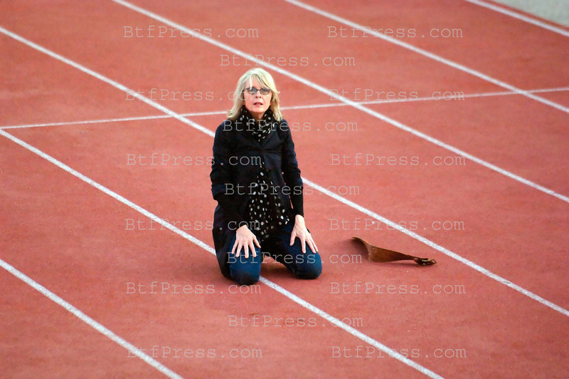 Diane Keaton running to a track field at UCLA in Santa Monica,California and wearing a long coat and jeans, she look like making a training for a role in a movie or to be a director for a future one, after that, she started to do some Yoga exercises.