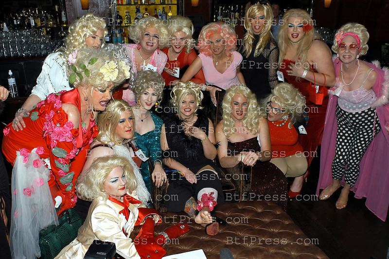 "West Hollywood,CA - FEBRUARY 18 : Playmate Anna Nicole Smith, poses with Drag Queens during the celebration of the city of West Hollywood to declare February 18 ,2003 "" Anna Nicole Smith Day"" in conjonction with a  Drag Queen cast call for the Genesis Films production of Wasabi Tuna at the Abbey on  February 18, 2003 in West Hollywood , California. Vickie Lynn Marshall (November 28, 1967 – February 8, 2007), better known under the stage name of Anna Nicole Smith,[1] was an American model, sex symbol, actress and television personality. She first gained popularity in Playboy, becoming the 1993 Playmate of the Year. She modeled for clothing companies, including Guess jeans and starred in her own reality TV show, The Anna Nicole Show. Born and raised in Texas, Smith dropped out of high school and was married at the age of 17. Her highly publicized second marriage to oil business executive and billionaire J. Howard Marshall, 63 years her senior, resulted in speculation that she married the octogenarian for his money, which she denied. Following his death, she began a lengthy legal battle over a share of his estate; her case, Marshall v. Marshall, reached the U.S. Supreme Court on a question of federal jurisdiction. In the months before her death, she was the focus of renewed press coverage surrounding the death of her son, Daniel Smith, and the paternity and custody battle over her daughter Daniellynn."