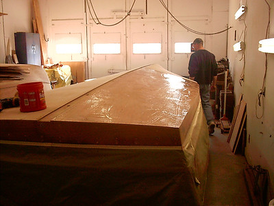 Glue being applied between first and second layer of plywood.