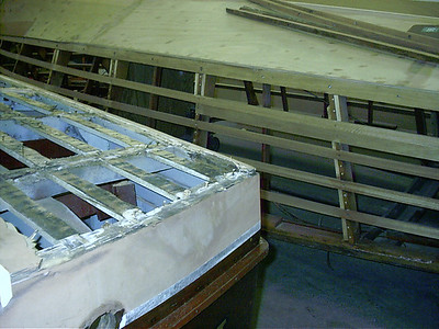 Port rear corner with bad wood in the chine and transom.