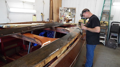 Removing the last section of the port cover board.