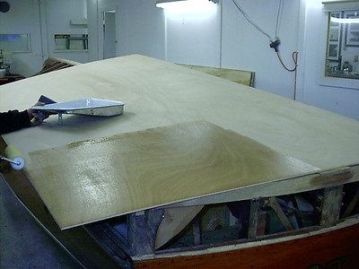 Coating the inside of the plywood with West System epoxy before we fit the bottom.