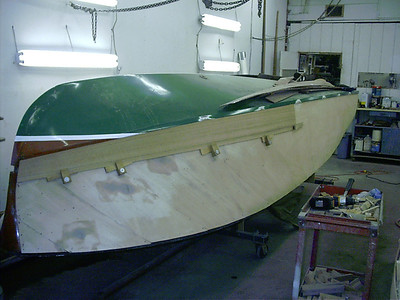 Starting to fit new planks on the starboard side.