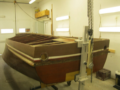 Hull rolled upside down with turn over jig still attached.
