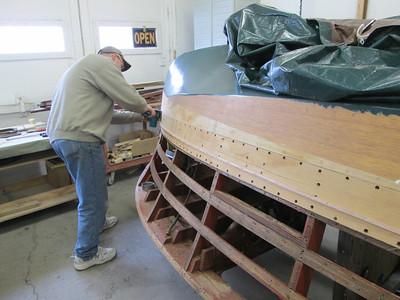 Removing the second plank down from the chine on the starboard side.