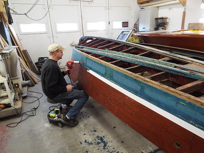 Removing the bottom starboard side plank.