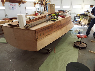 Rear view of the first two port side planks epoxied in place. Being held in place with temporary fasteners.