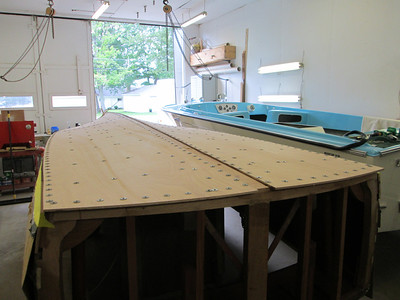 Starboard rear view of first layer of plywood installed and held in place with temporary fasteners.
