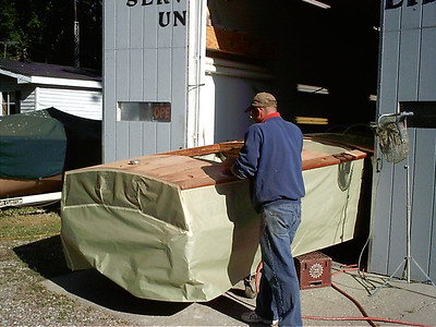 Sanding rear deck.