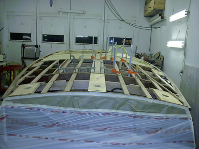 Installing new battens and king plank in the engine hatch.