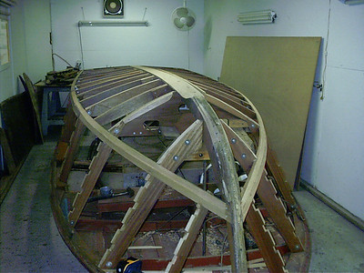 Port side with all new frames keel and chine faired and ready for bottom skin
