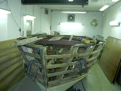 Bad parts of king plank and port shear plate removed.