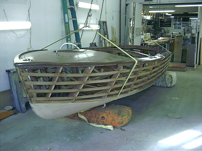 Turned the boat right side up to remove the deck before the sides are skinned and planked.
