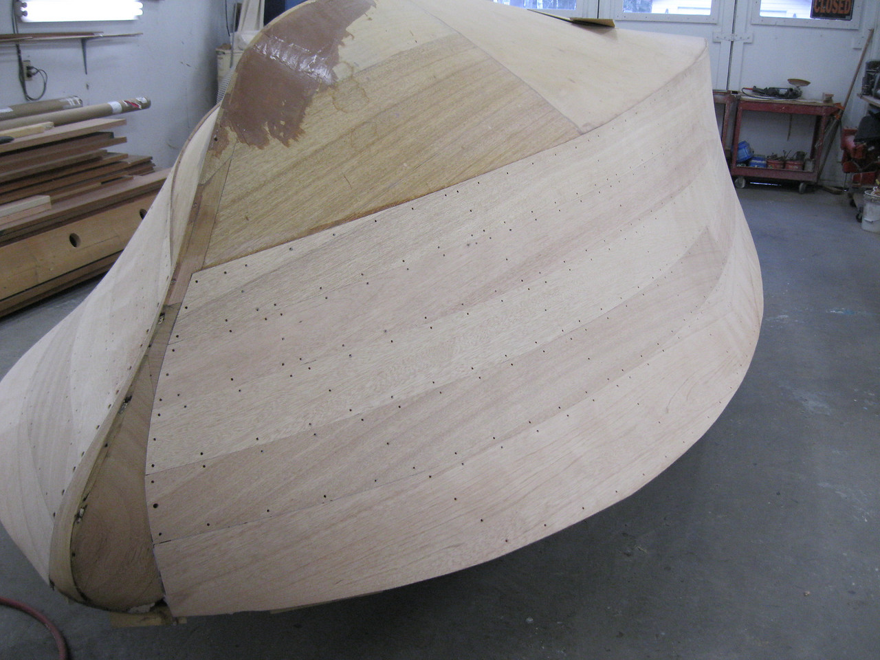 Starboard front view of the side sanded for the first time and ready to drill for plugs.
