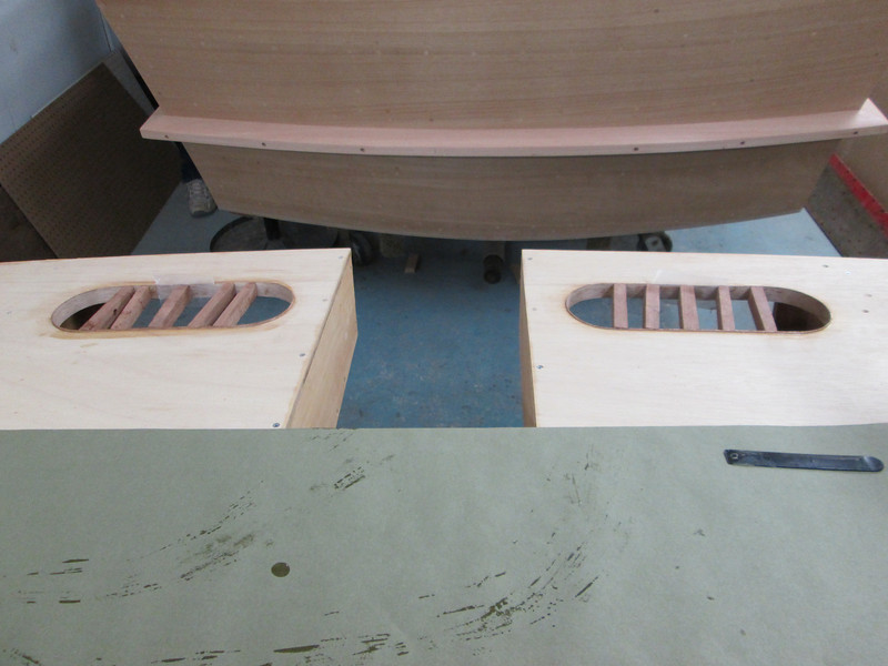Installing Mahogany caps to cover the plywood end grain in the storage openings.