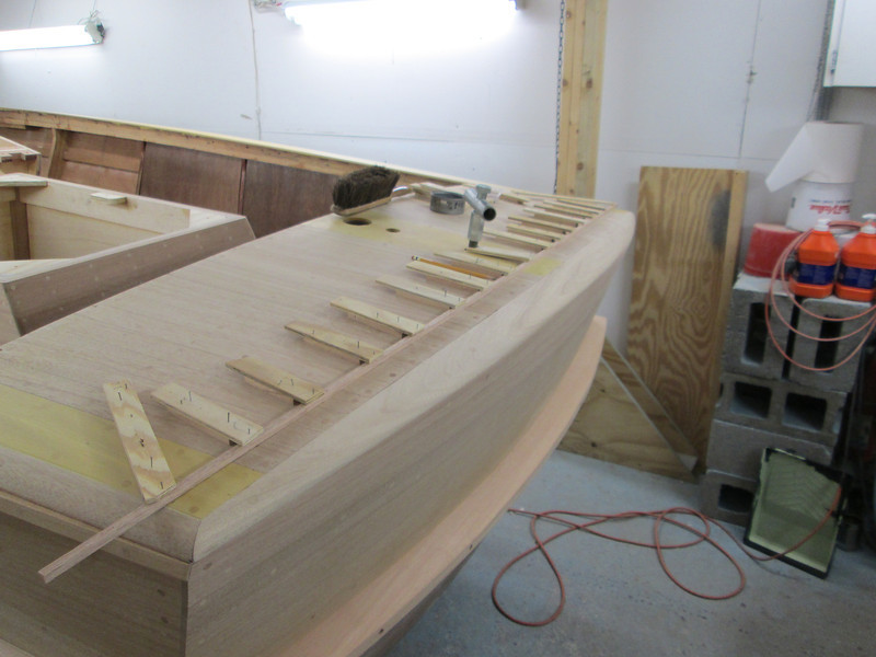 Routing the deck seam across the transom.