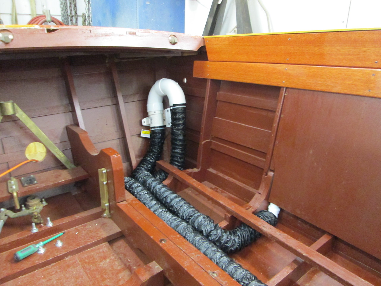 Because this boat was not designed for a bilge blower we had to custom make this set up so the blower exits on the rear clam shell port side.