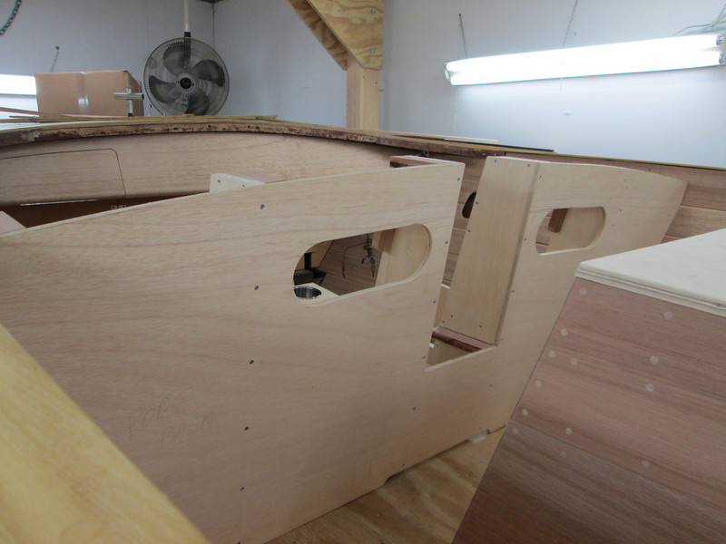 Front seat frame being mounted inside the boat.