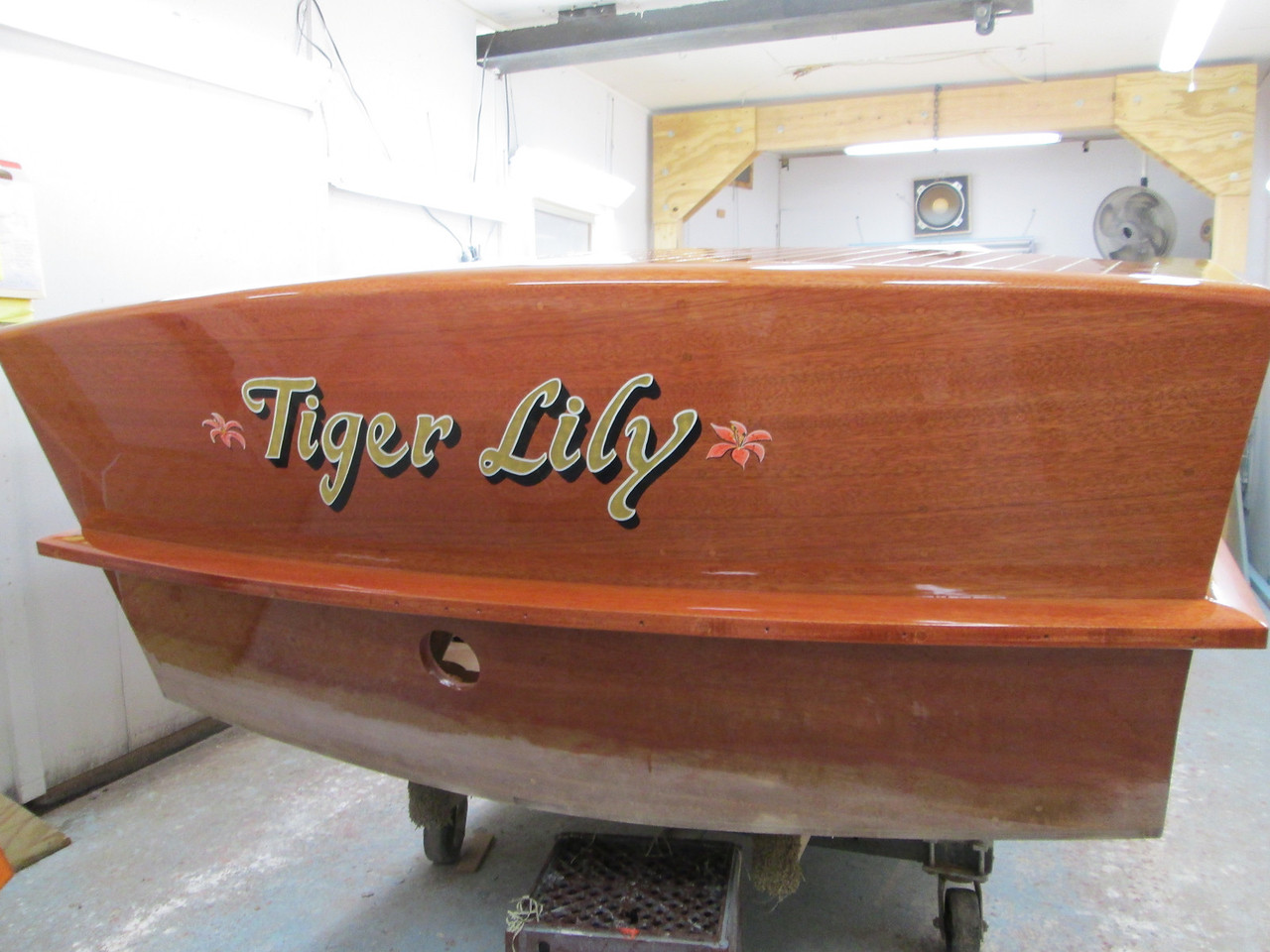 Gold leaf lettering done by Dan Davidson with one coat of varnish applied over the lettering.
