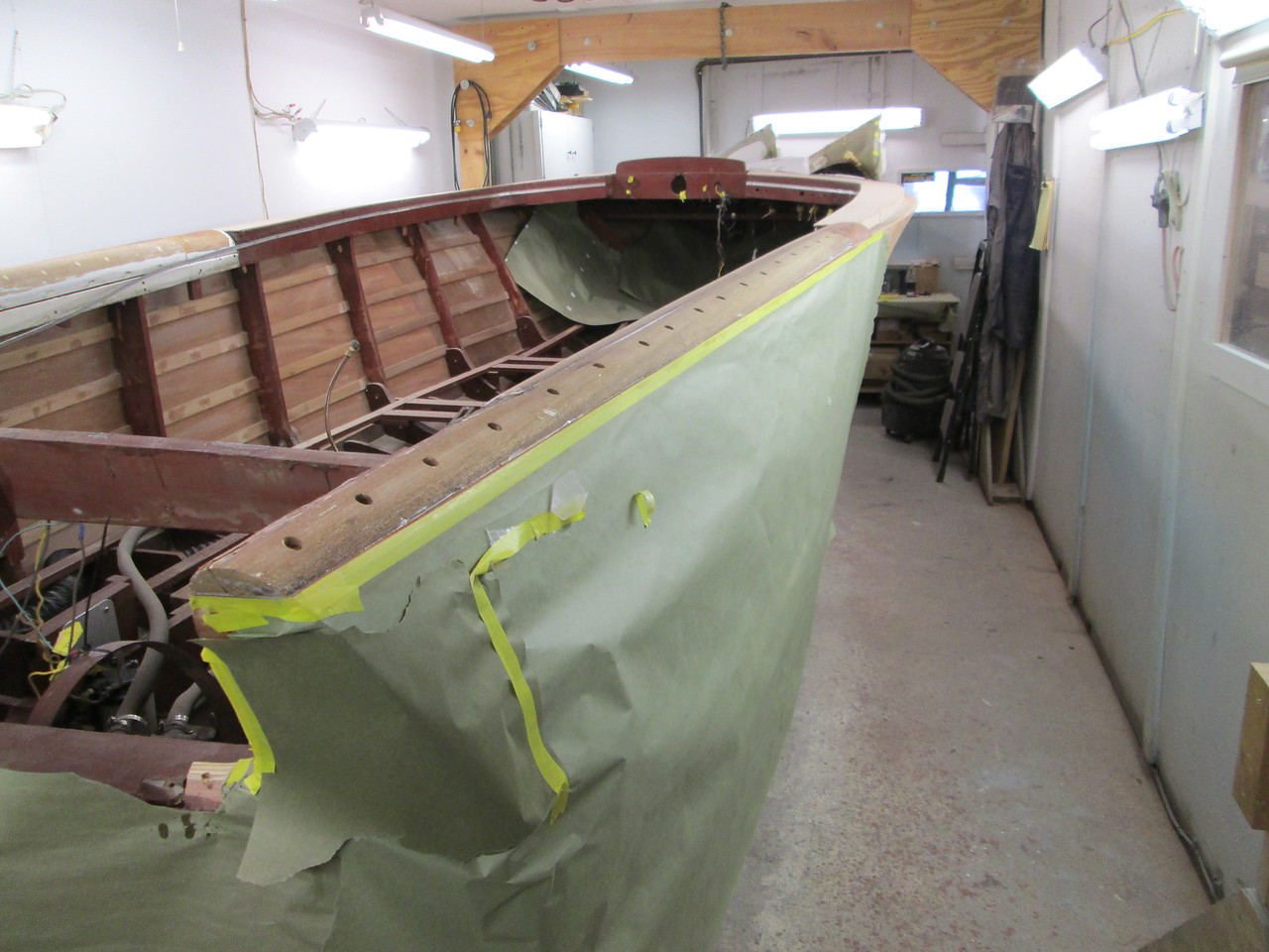 Getting ready to plug the screw holes in the top of the rear starboard fin.