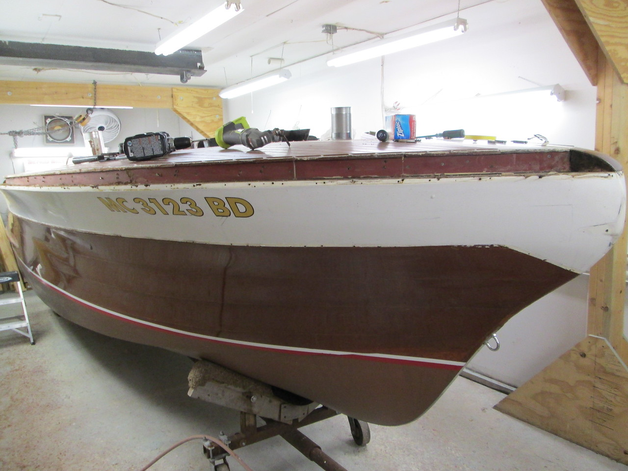 Another view of the starboard cover board and all the starboard trim and rails removed.