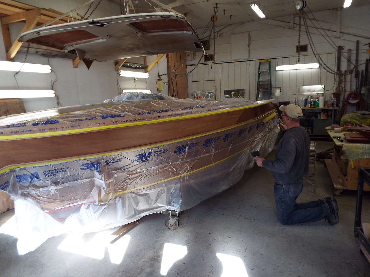Another view of the port top plank being coated.