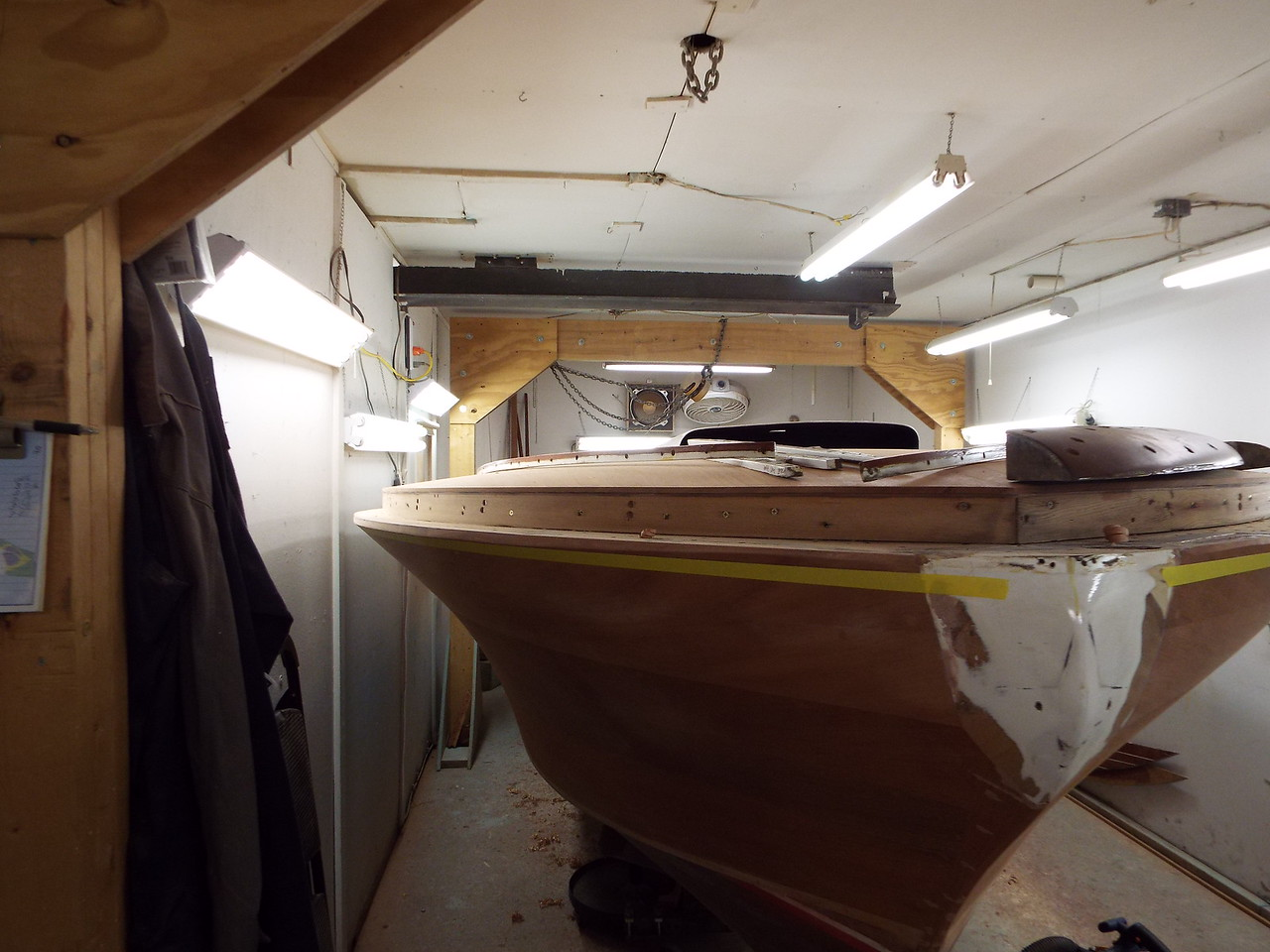 Fairing the starboard shear line before starting to fit the new cover boards.