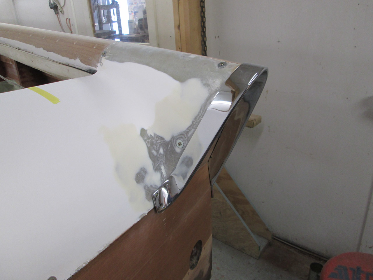 Starting to fit the starboard fin hardware after the glass was added to the rear deck.