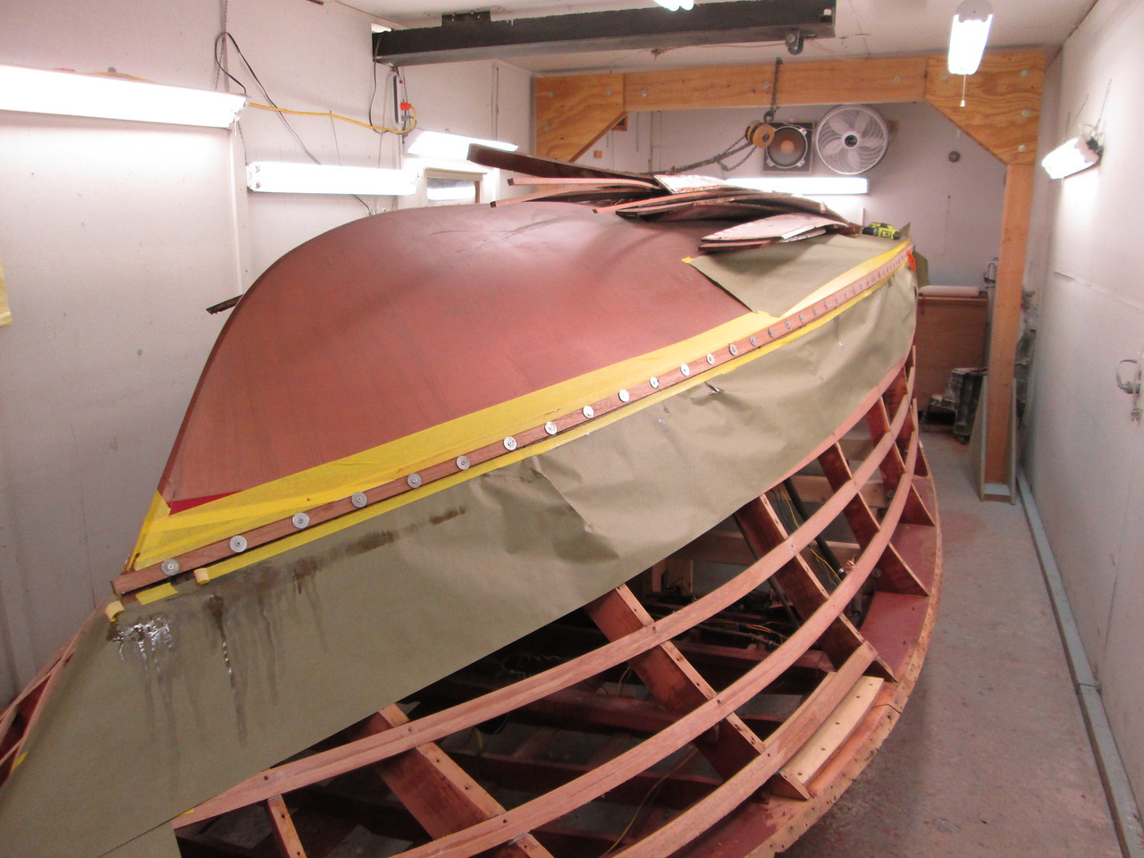 Starboard chine cap installed with temporary fasteners.