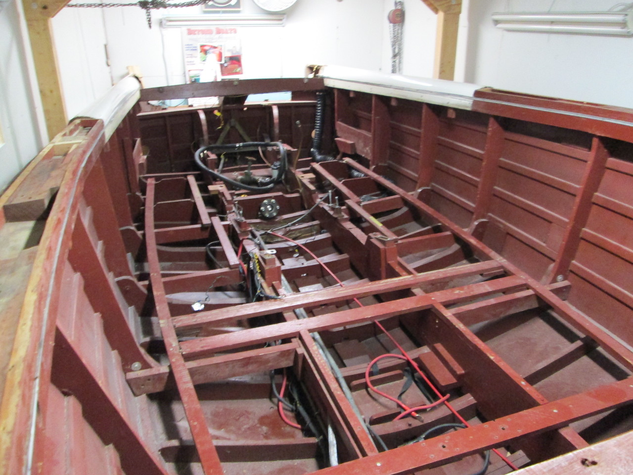 View of the inside with everything removed including the front and rear deck. Next we will wash out the bilge and turn the boat up side down.