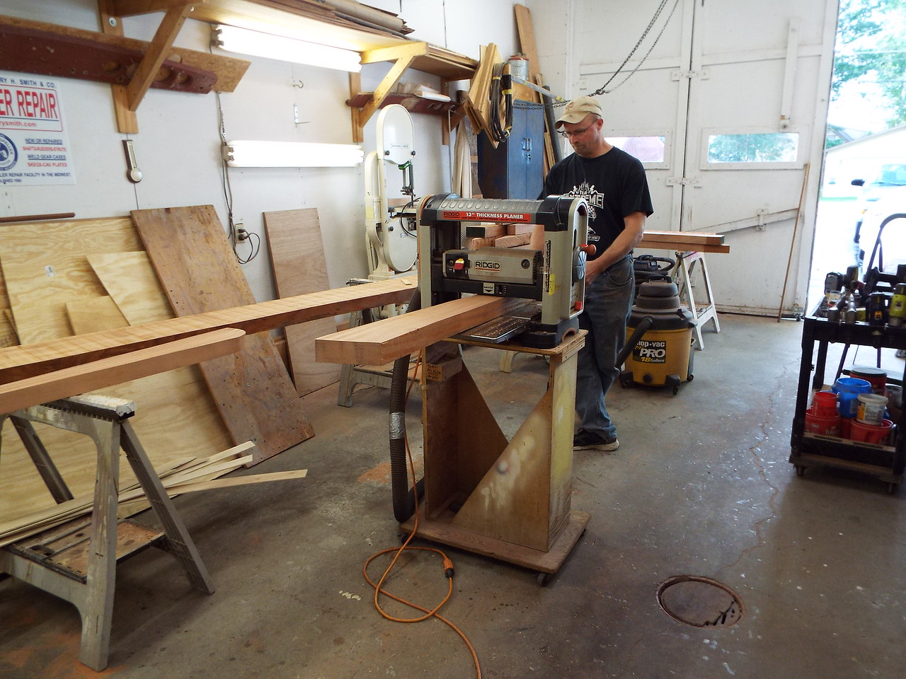 Another view of the new cover boards being run through the planer.