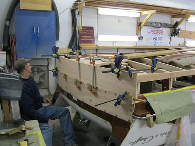 Fitting new transom planks.