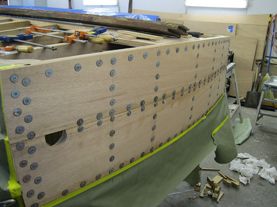 New transom planks glued in place and held with tempory fasteners.