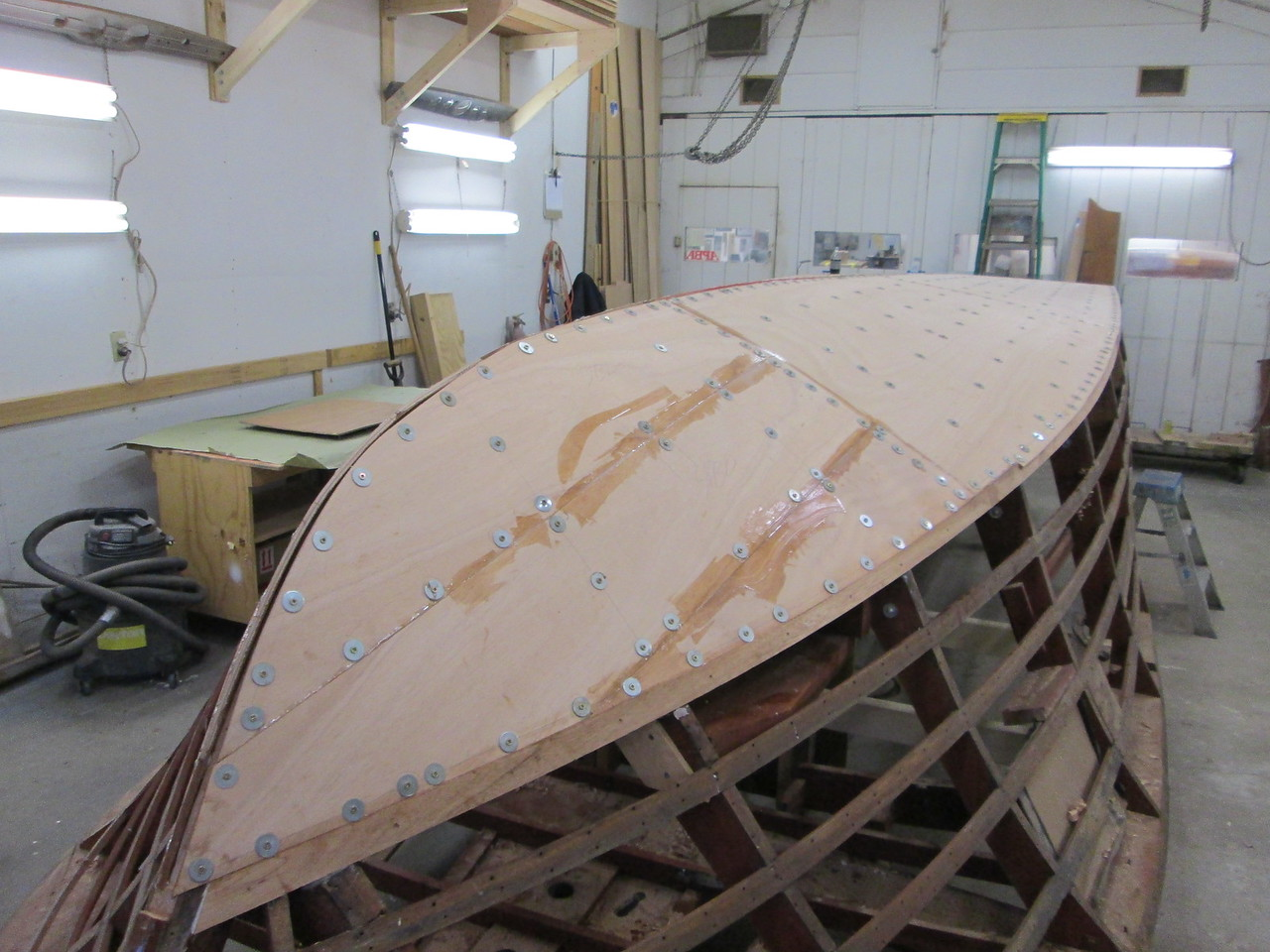 Front starboard view of the first layer of bottom skin installed.