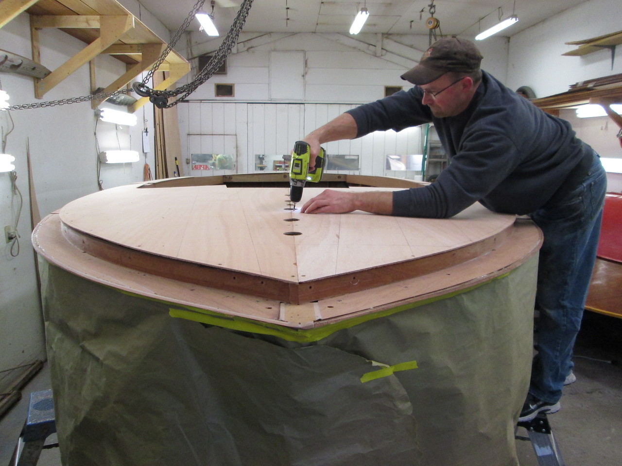 Attaching the deck skin with temporary fasteners.