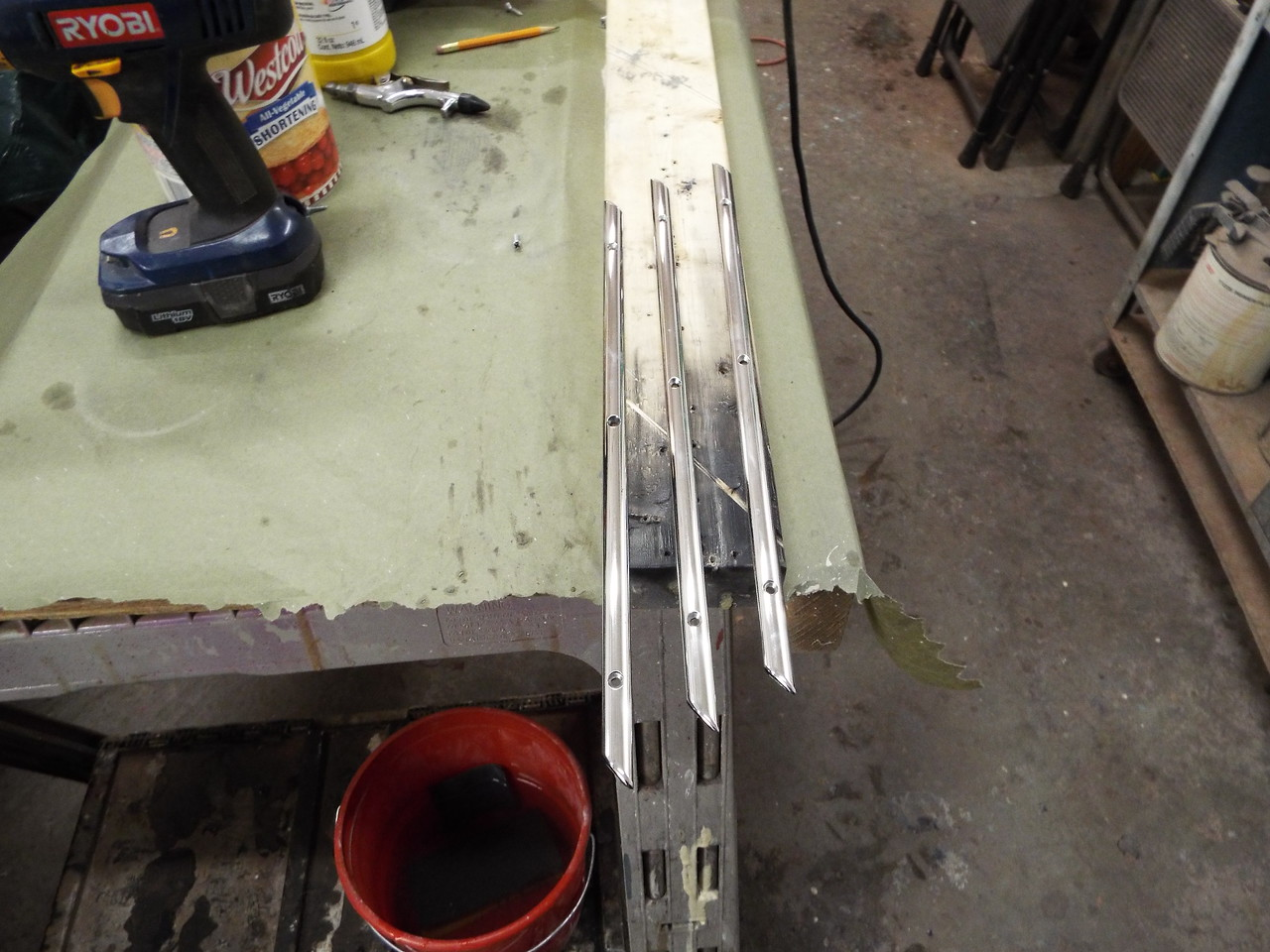 Three custom pieces of trim made and polished for the starboard side.