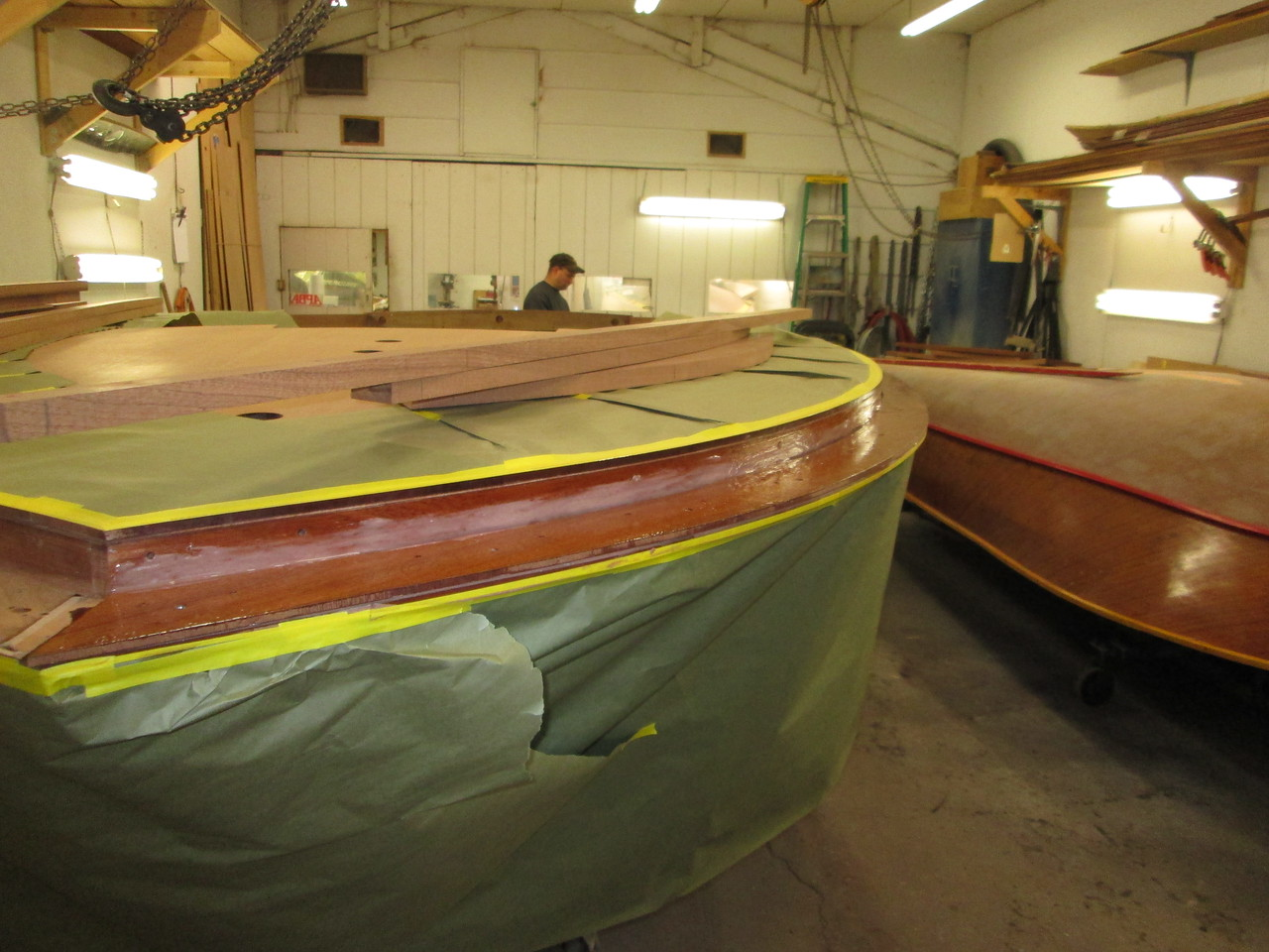 Epoxy being applied to the port side for the cover board