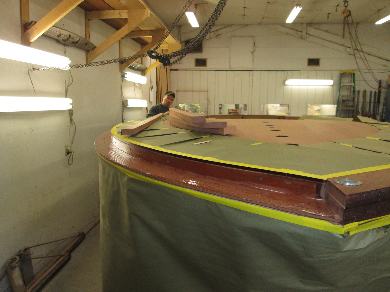Starboard cover board epoxy being applied.