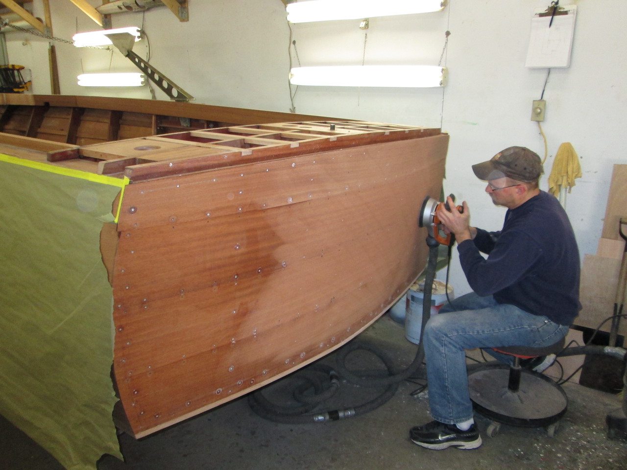 Sanding the transom before drilling for plugs.