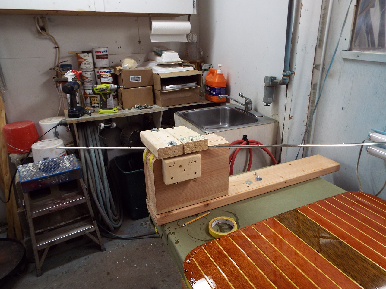 Another picture of the jig with a piece of trim installed before it was bent.