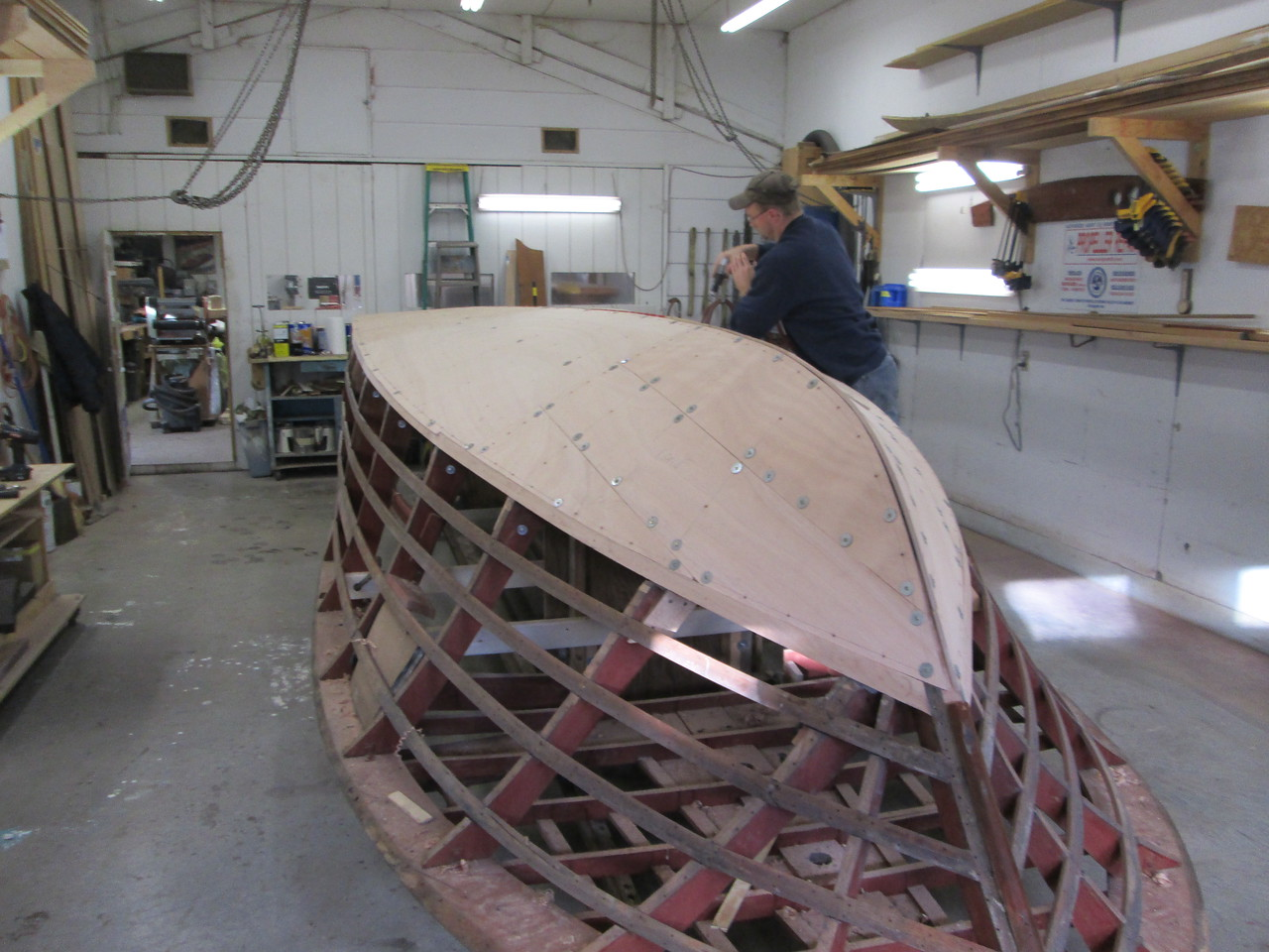 Port front view of the first layer of bottom fit and being drilled.