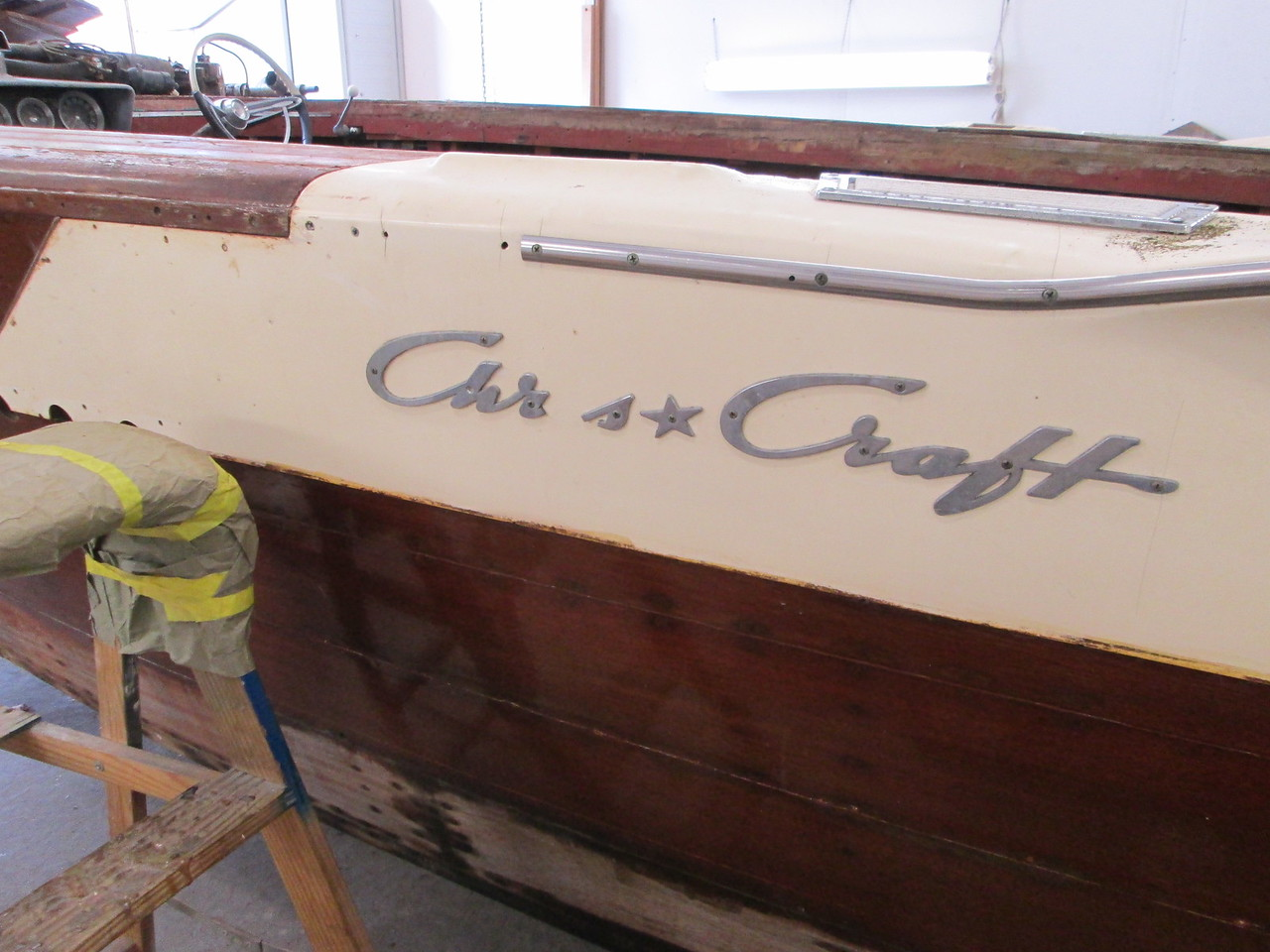 Damaged Chris Craft logo.