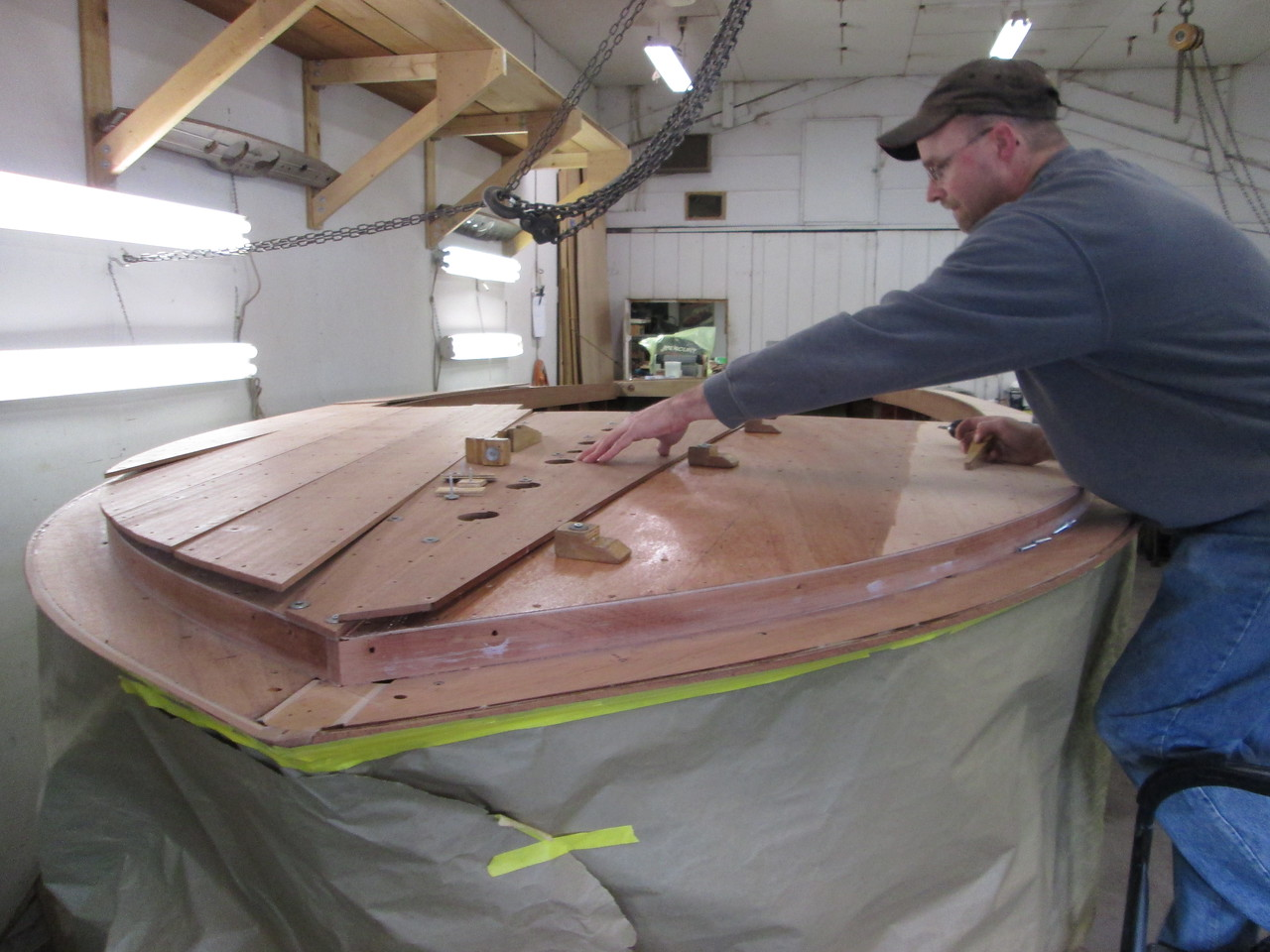 Front deck planks being attached to the hull.