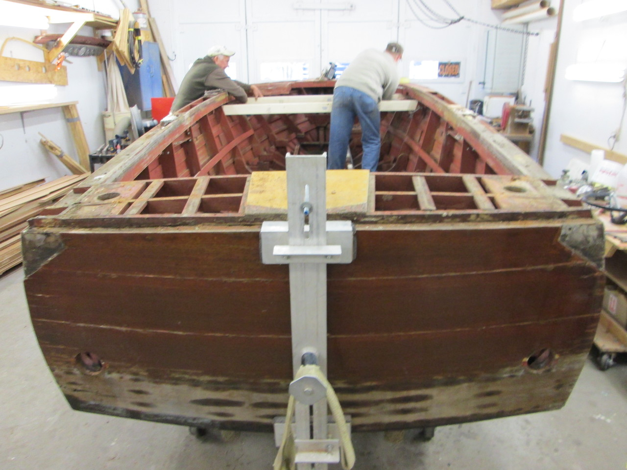 Getting the hull ready to turn over.