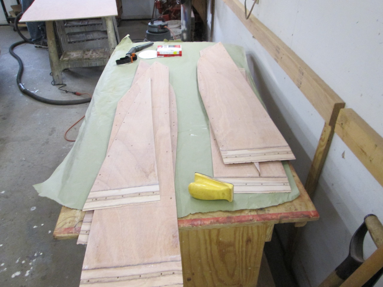 Front bottom pieces with three coats of epoxy applied to the inside surface and sanded.